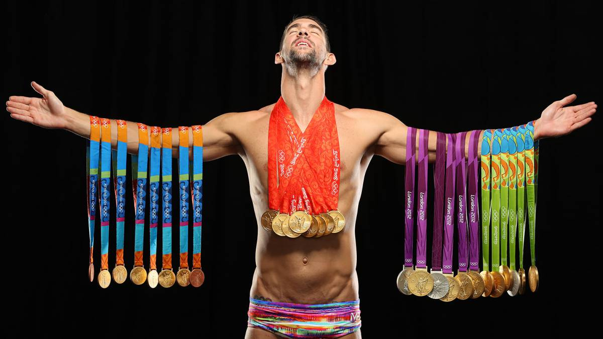 Swimmer Michael Phelps poses with all 28 Olympic medals ...