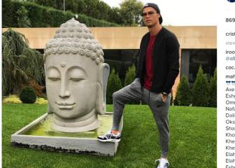 Cristiano causes outrage with Buddha statue photo